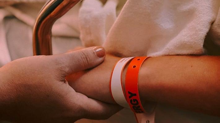 parent holding child patient's hand